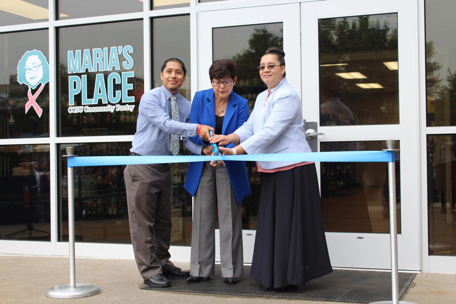 From left to right: Maria's Place Coordinator Freddy Rios, CCSU President Dr. Zulma Toro and Maria A. Alvarez's daughter Melina Lopez cut the ribbon for Maria's Place Friday.