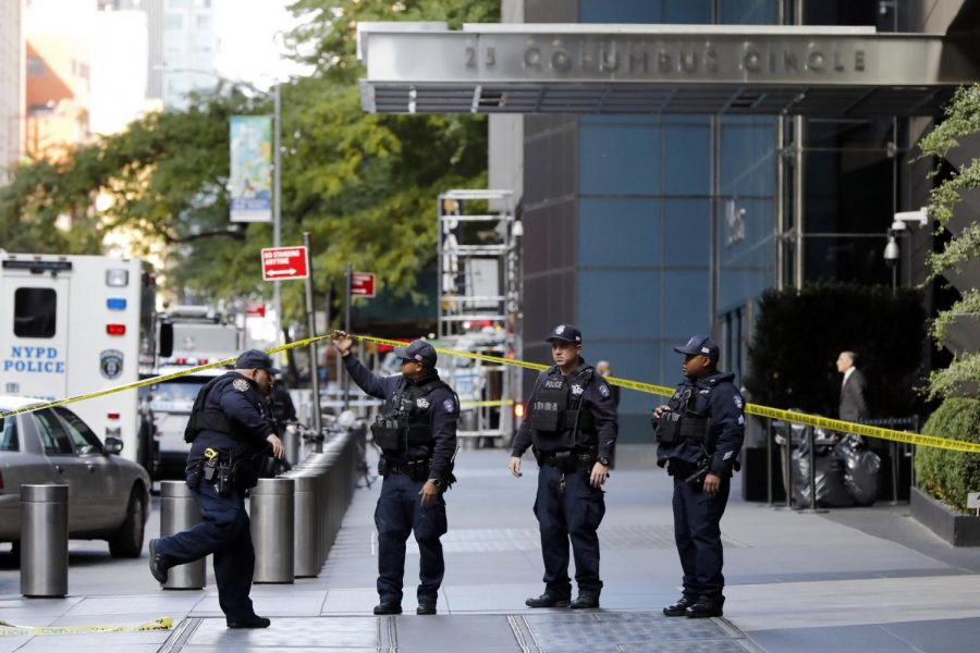 Officers stand outside the Time Warner Center after a suspicious package was sent to CNN last week.