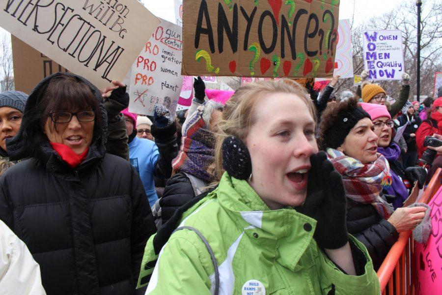 Danielle Brochu of East Hartford chants along at the Women