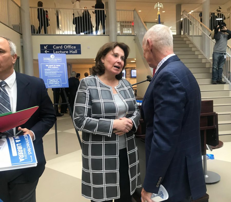 CCSU alum Carol A. Ammon shakes hands with CSCU President Mark Ojakian at last week's ribbon cutting for Willard-DiLoreto halls.