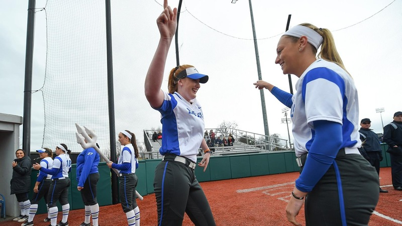 Sydney Bolan (left) had two home runs in the first two games.