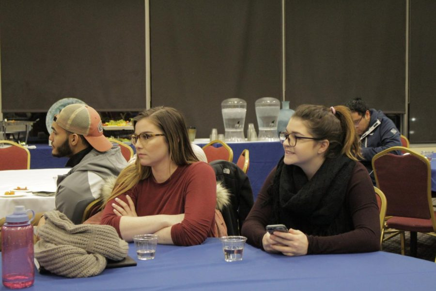 Current SGA President Kassandra Fruin, left, and Treasurer Kristina DeVivo, right, watch Monday's SGA debate.
