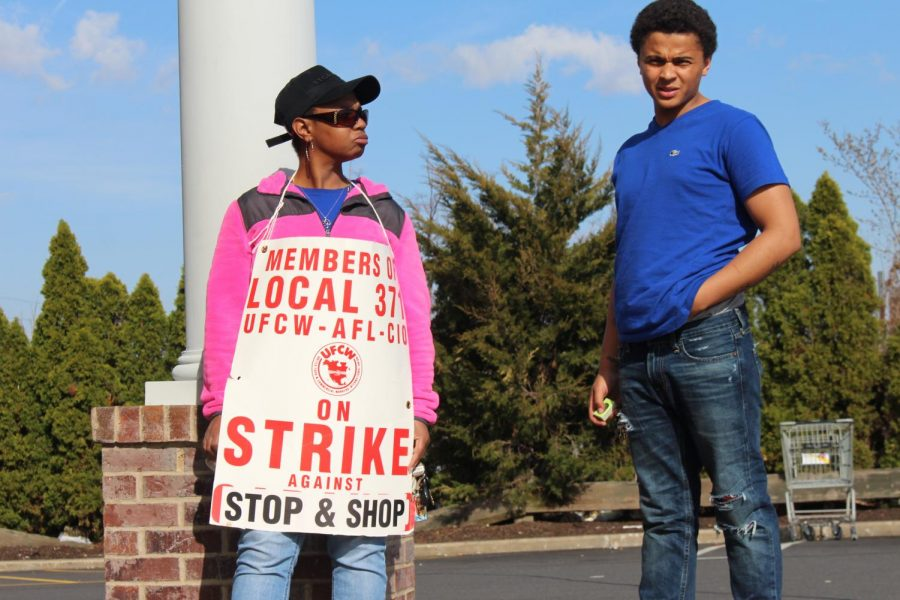 Joyce Moore, an employee of five years at the New Britain Stop and Shop, left, was on strike with her son at her side last Saturday.