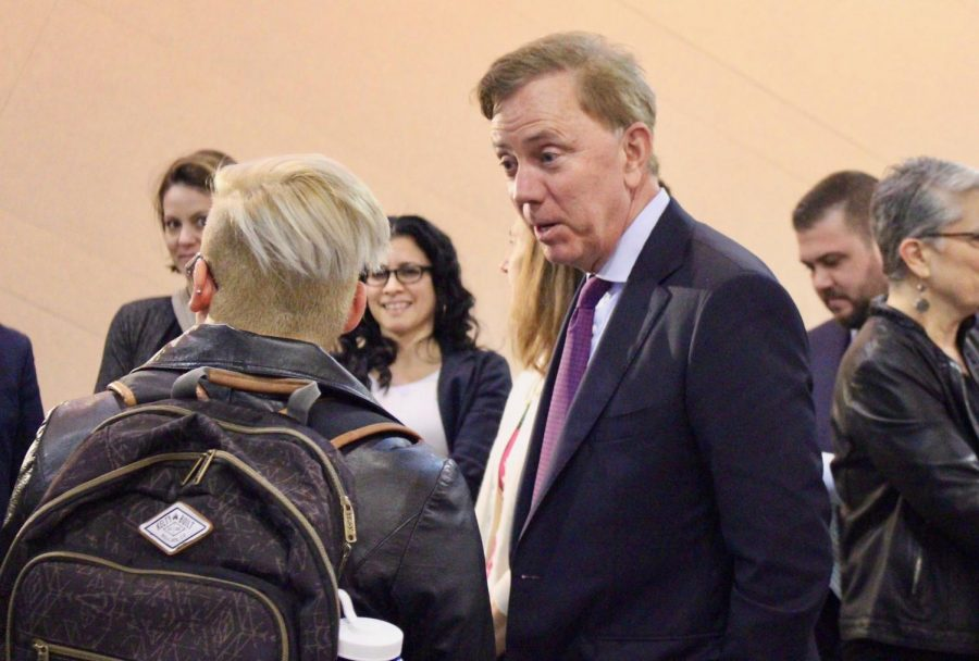 Governor Ned Lamont speaks with CCSU student Justin Vega.