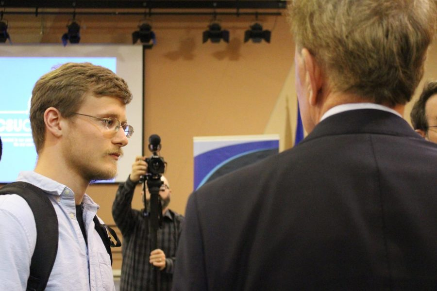 CCSU student Justin Boutin asks Governor Ned Lamont about his proposed textbook tax.