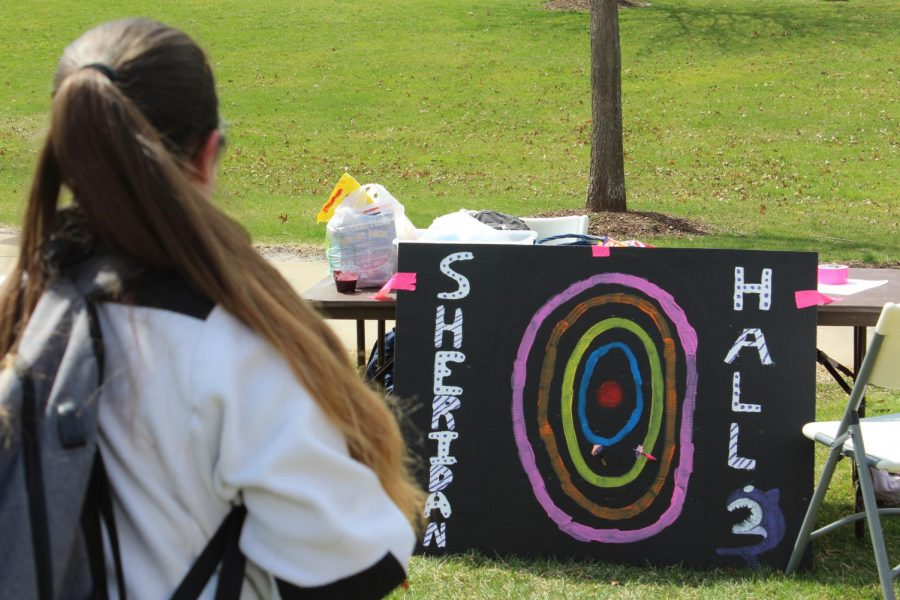 Sheridan Hall hosted their own booth involving questions about sex and a dart board.