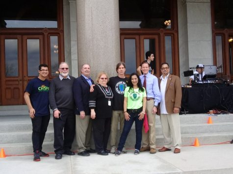 "Speakers at the ""Stand Up For Climate Action and Equity"" rally pose on the steps of the Capitol on Sunday."