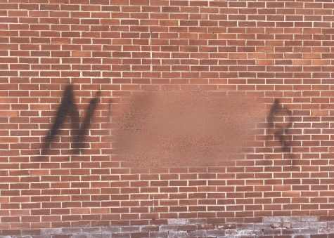 One racial slur was spray painted outside the Student Center facing Welte Garage.