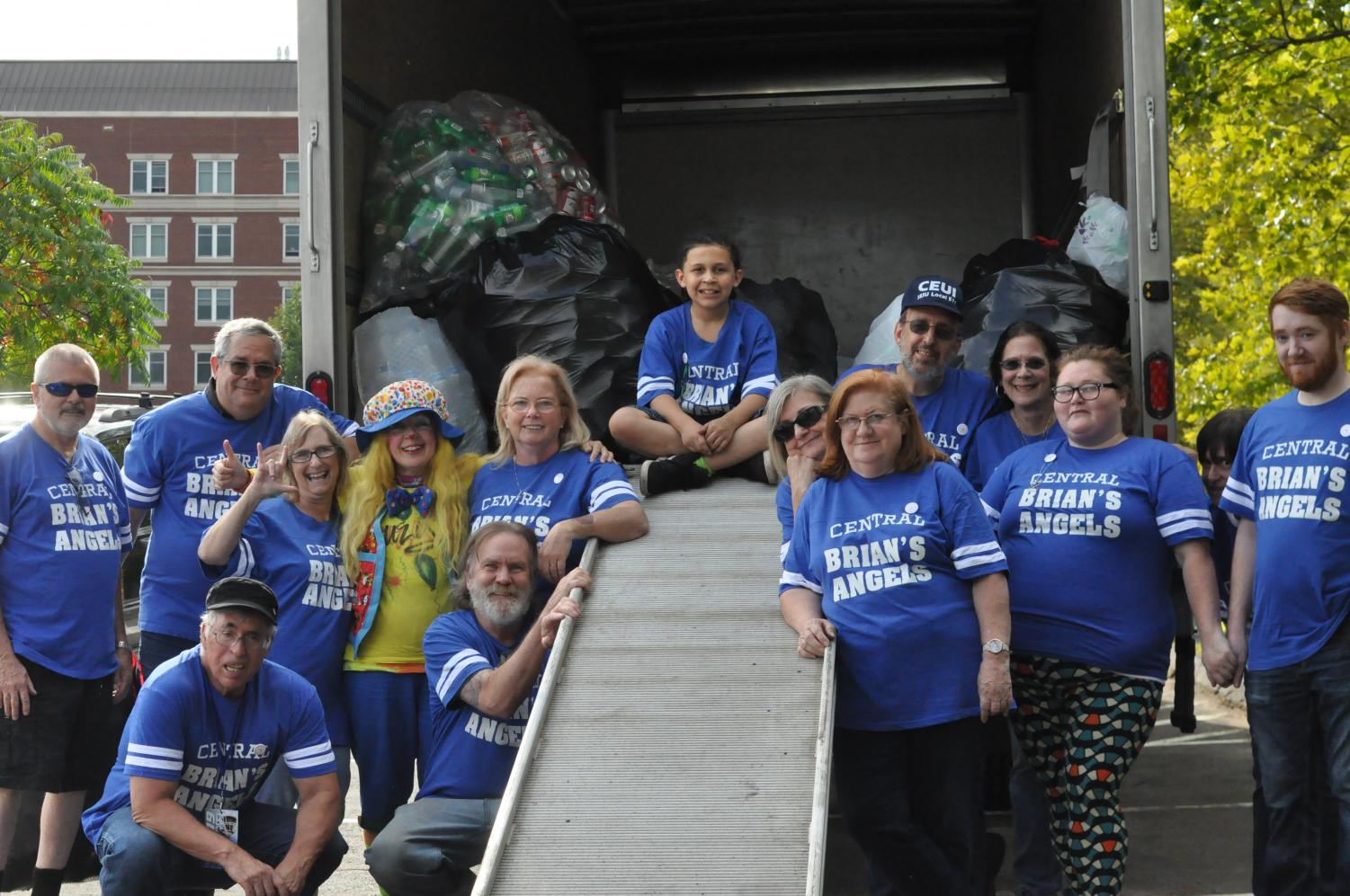 All+of+the+Brian%27s+Angels+volunteers+standing+with+their+truck+full+of+donations.