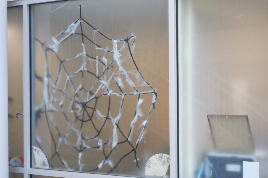 The Wellness Center in Willard-DiLoreto displays a giant fake spiderweb in the window.