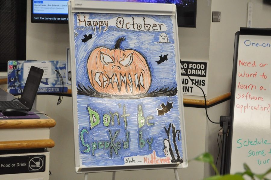 Jennifer Rosario from the Marcus White computer lab decorated the whiteboard with a jack o'lantern and wrote,