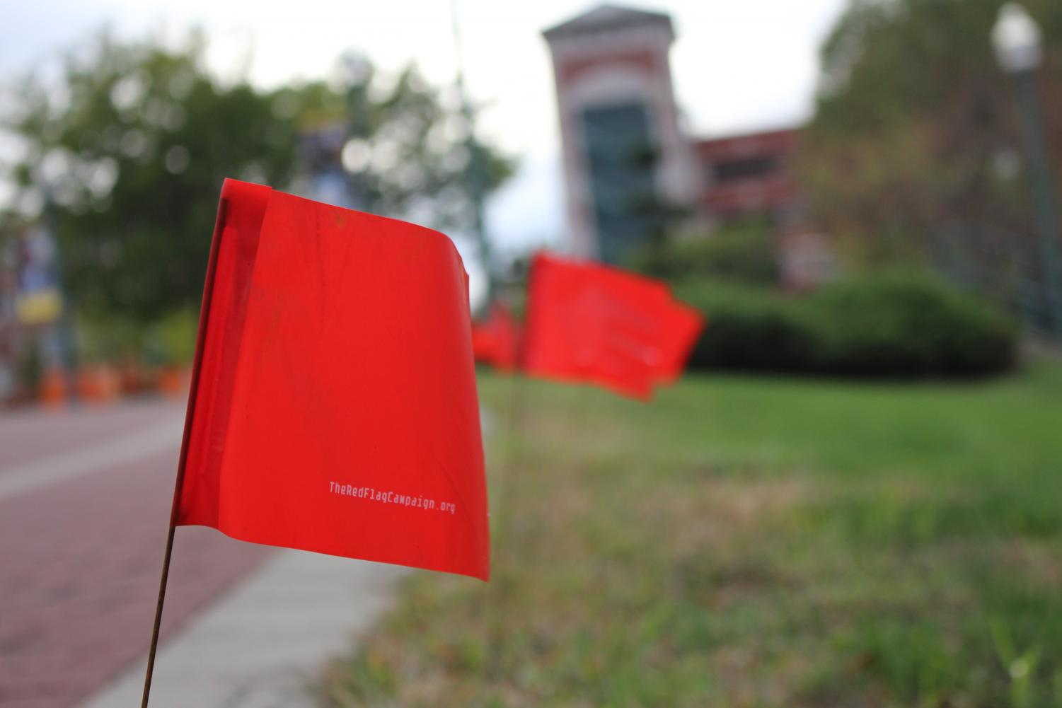 The red flags are meant to raise awareness to dating violence and prevention.