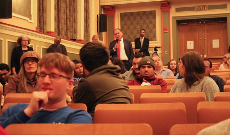 Political Science Professor Ghassan El-Eid asks speaker John Esposito a question.