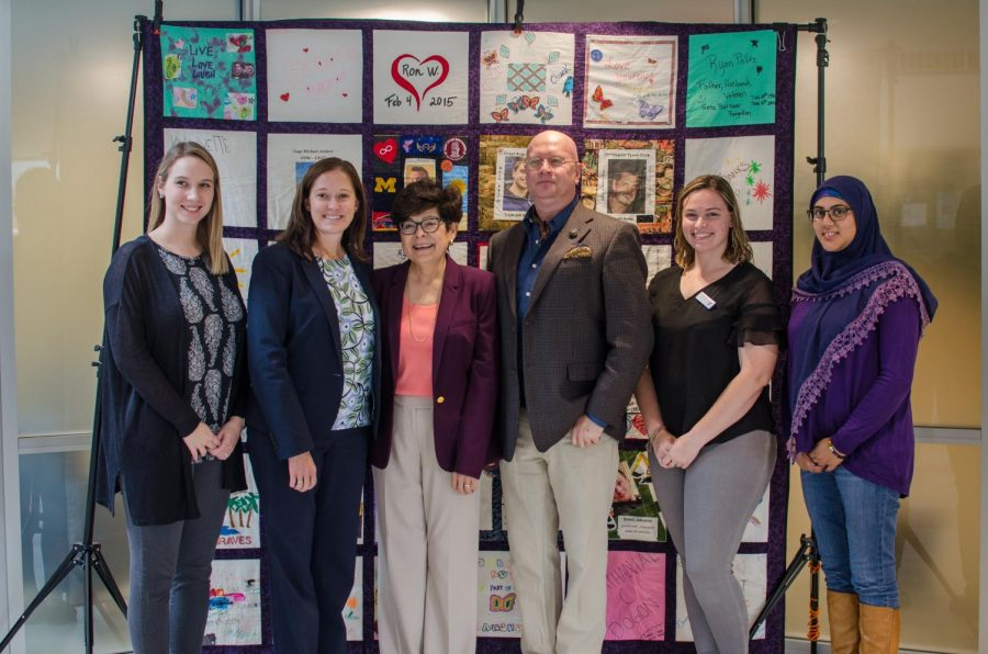 President Toro and the event's organizers in front of the quilt.