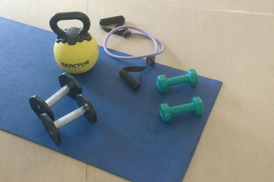 Weights and bands are some of the equipment used in Borns H.I.I.T. class.