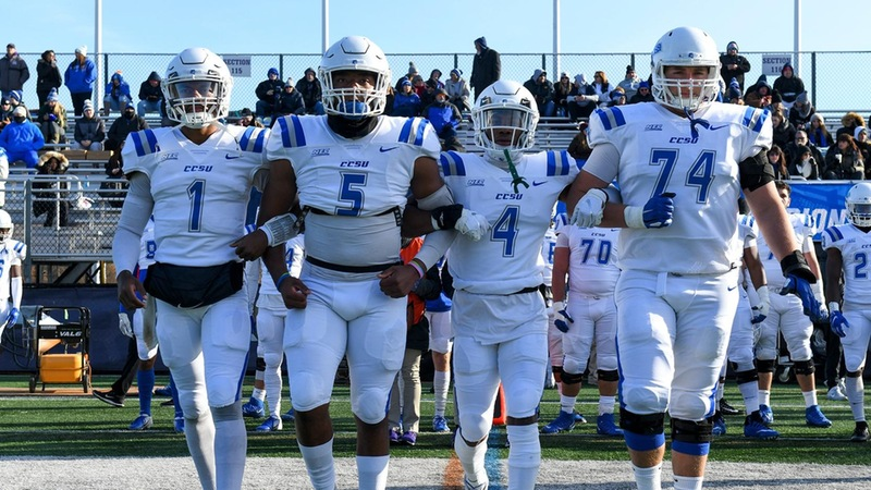 (Left to right) Aaron Winchester, Tre Jones, Tajik Bagley and Connor Mignone walking out for the coin toss against the University of Albany.