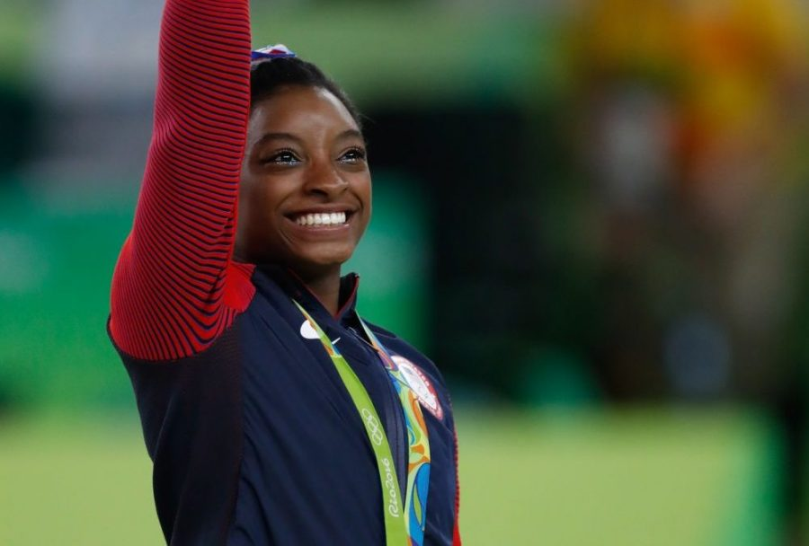 Simone+Biles+is+one+of+many+elite+athletes+debating+if+they+should+compete+in+the+2021+Olympic+Games.