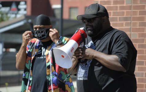 Christopher Dukes stands with his supporters outside of Hartford Police Department sharing his truth.