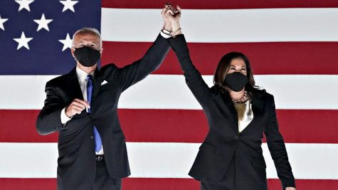 Former Vice President Joe Biden, Democratic presidential nominee, left, and Senator Kamala Harris, Democratic vice presidential nominee, wear protective masks while holding hands outside the Chase Center during the Democratic National Convention in Wilmington, Delaware, U.S., on Thursday, Aug. 20, 2020. Biden accepted the Democratic nomination to challenge President Donald Trump, urging Americans in a prime-time address to vote for new national leadership that will overcome deep U.S. political divisions. Photographer: Stefani Reynolds/Bloomberg via Getty Images