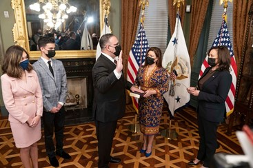 Miguel Cardona is sworn in by Vice President Kamala Harris (Photo via @SecEducation on Twitter)