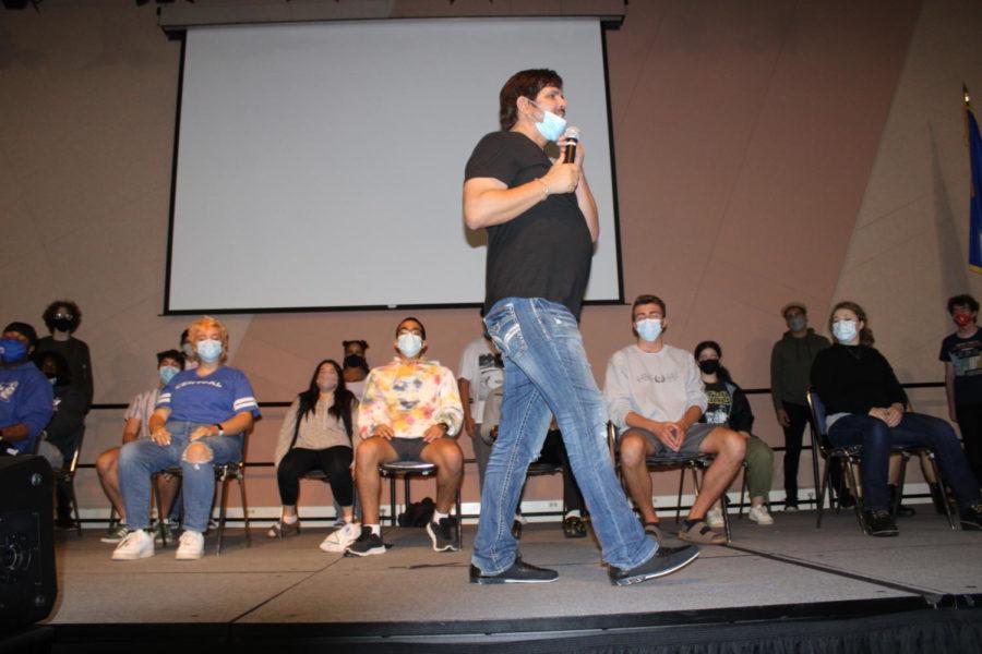 Anthony explains the mechanics of hypnotism while students behind him await instructions.