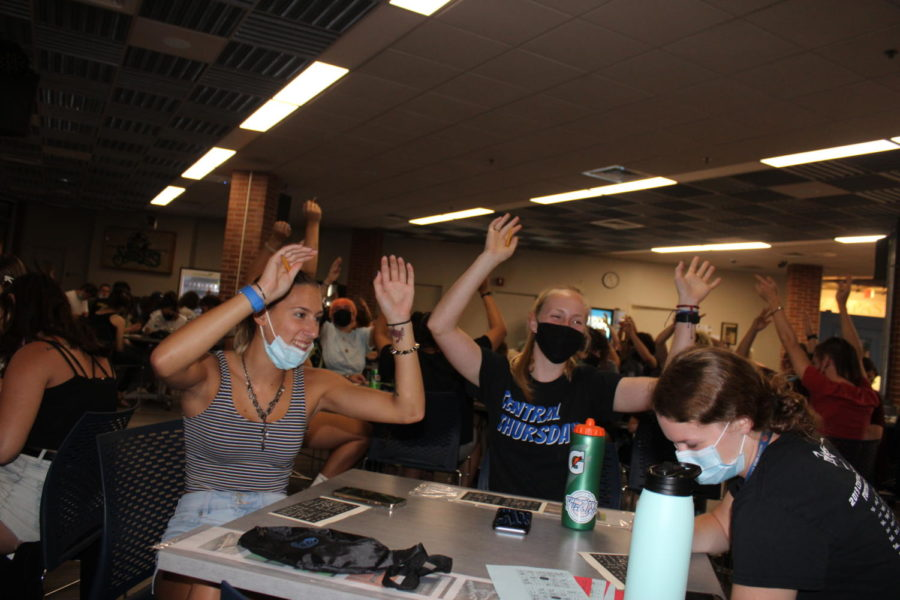 Students at SGAs Music Bingo put their hands in the air during DJ Khaleds All I Do is Win.